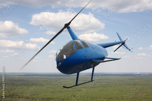 Aircraft - Blue Helicopter flight sky and clouds background