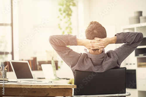 Poster de jardin Detente Working man resting in office