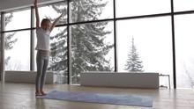 Little Child Girl Doing Gymnastics Exercises Acrobatic Wheel At The Gym On Yoga Mat