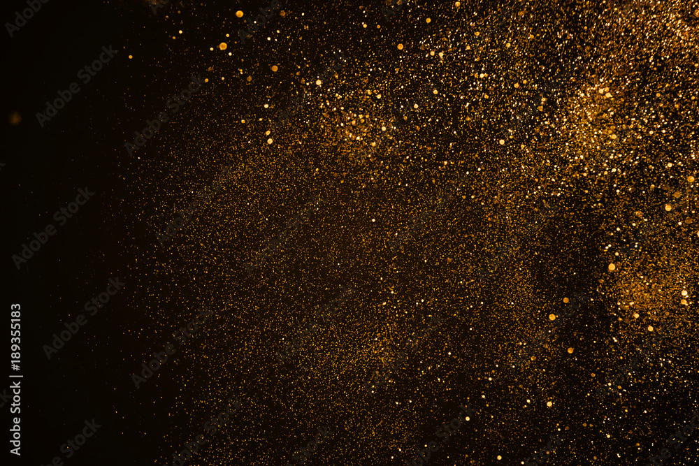 Fototapety, obrazy: christmas gold sparkle glitter explosion dust particles background with bokeh, gold holiday happy new year and valentine day concept
