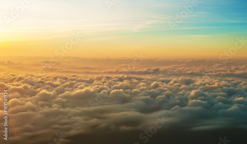 white fluffy clouds at sunrise