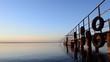 Old pier in clear water Seamless loop
