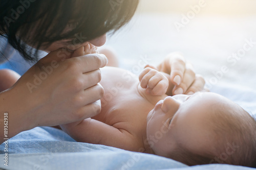 mother's love tenderness hands kiss newborn baby concept Tableau sur Toile