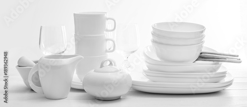 Fotografía  Set of plates and cutleries on light background