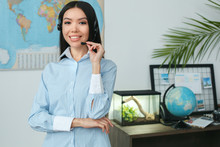 Young Female Travel Agent Cons...