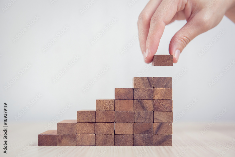 Fototapety, obrazy: Close up Woman hand arranging wood block stacking as step stair. Business concept growth success process.