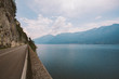 Driving on a scenic road along Lake Garda, Italy. Summer time. European vacation, living, life style, architecture and travel concept