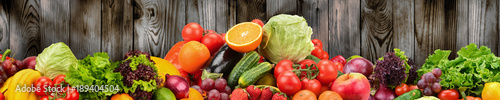 Fruits and vegetables on background of wooden wall. Healthy vegetarian food. © Serghei Velusceac