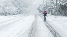 Man Riding Bike In The Snow