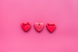 Heart shaped cookies for Valentine's Day on pink background top view copy space
