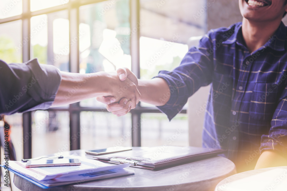 Fototapety, obrazy: Business People Hand Shake in cafeteria.