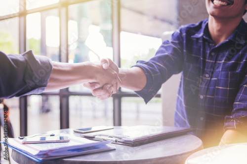 Fotografie, Obraz  Business People Hand Shake in cafeteria.