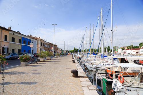 Tuinposter Stad aan het water Scenic view of pier with ancient buildings, ships, yachts in Pesaro, Marche, Italy
