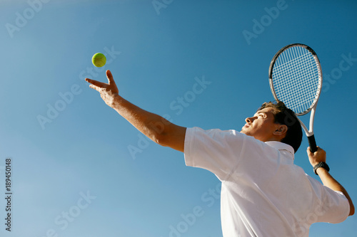 Tennis Sport. Man Playing Tennis Outdoors