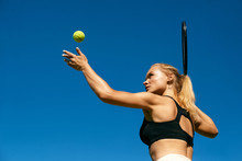 Sports Woman Playing Tennis Outdoors