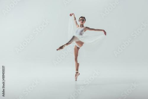 Fotografie, Tablou  young elegant ballerina dancing in studio, isolated on white