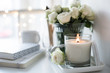 Leinwanddruck Bild - White room interior decor with burning hand-made candle and bouq