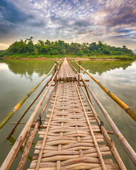 Panel Szklany Podświetlane Mosty Beautiful view of a bamboo bridge. Laos landscape.