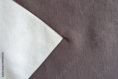 White triangular gusset sewn to brown fabric Canvas-taulu