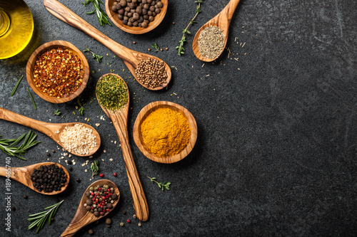 Photo Stands Spices Cooking table with spices and herbs
