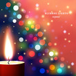 Abstract vector Illustration. Candle in the foreground with bokeh effect and sparks. Christmas mood.