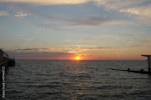 Foto op Aluminium Grijze traf. sea summer sun sunset evening