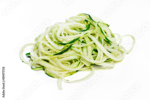 Raw ucchini noodles in a stack isolated