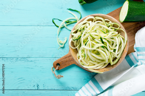 Raw zucchini noodles in a bowl
