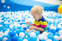 Kids Play In Ball Pit. Child P...