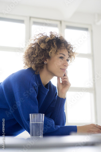 Portrait of smiling woman with credit card