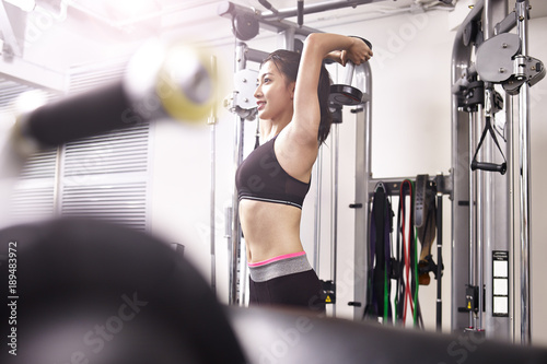 Fotografie, Obraz  young asian woman exercising working out in gym
