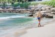 blonde woman in bikini on white tropic beach