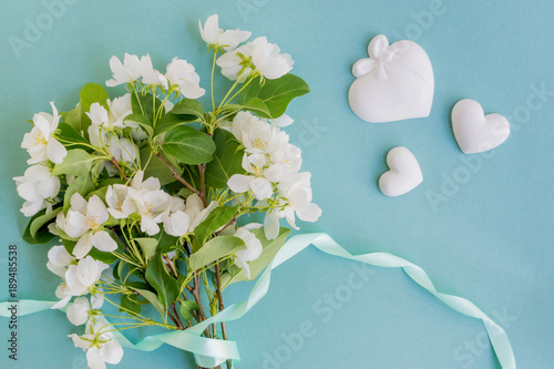 Staande foto Lelietje van dalen White spring flowers on a light blue background