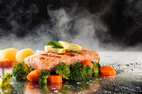 Photo Salmon and steamed vegetables.