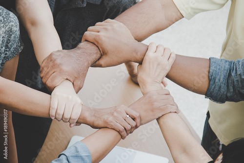 Fotografía Team work concept; close up of joining hands of businessman in unity cross proce