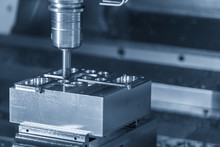 The CNC Milling Machine Cutting The Sample Part.The Chamfer Tool Cutting The Mold Part By CNC Milling Machine.