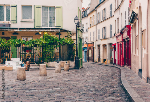Photo sur Toile Europe Centrale View of cozy street in quarter Montmartre in Paris, France