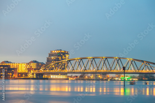 Railway bridge, apartments, houses and offices in the Dutch city of Nijmegen © Martin Bergsma