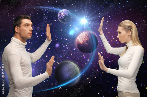 futuristic couple over planet and stars in space Canvas Print