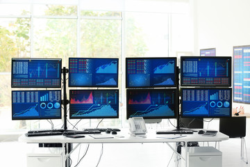Modern stock trader's workplace in office