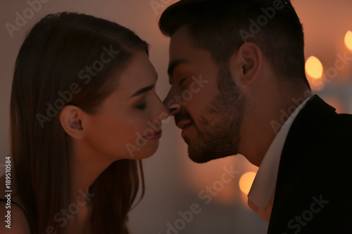 Foto op Plexiglas Wand Young couple kissing on romantic date