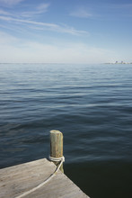 Lazy Day On The Dock Or Pier Overlooking Calm Blue Water