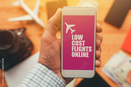 Fototapety, obrazy: Low cost flights online mobile phone app