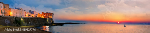 Panoramic sunset view of Gallipoli old city and sea, Apulia, Italy Canvas Print