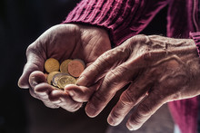 Pensioner Man Holding In Hands...