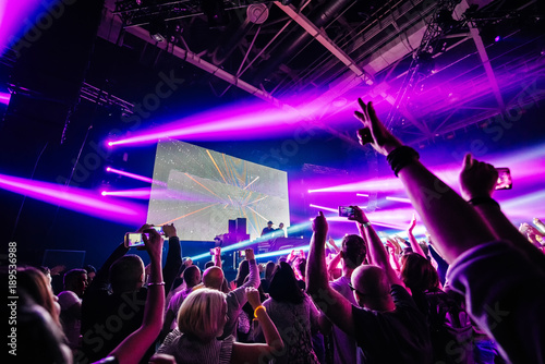 dj night club party rave with crowd in music festive Wallpaper Mural