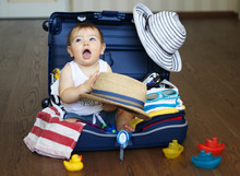 Baby In Suitcase Ready For Tra...