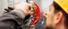 Electrician Engineer Tests Ele...