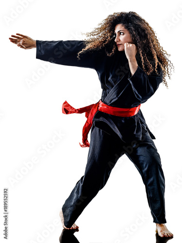 In de dag Vechtsport one caucasian woman practicing martial arts Kung Fu Pencak Silat in studio isolated on white background
