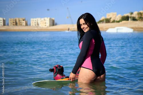 Wake Boarding Female Sportsman Beautiful Girl With Long Black Hair